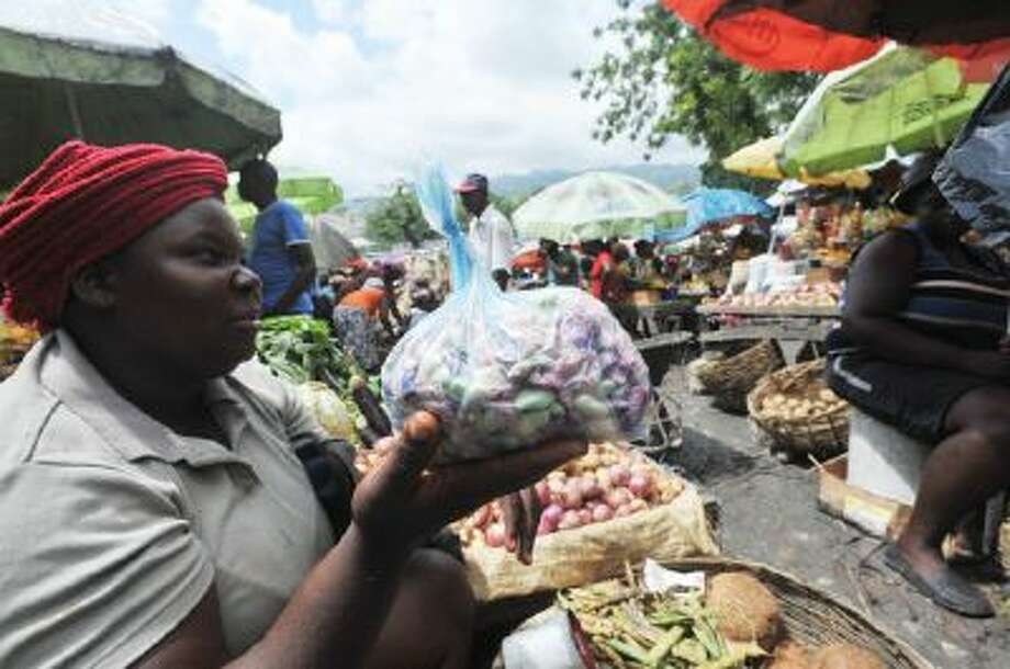Vendors sell fruit and vegetables on May 24 at an open-air market in the Petion-ville neighborhood of Port-au-Prince, Haiti.