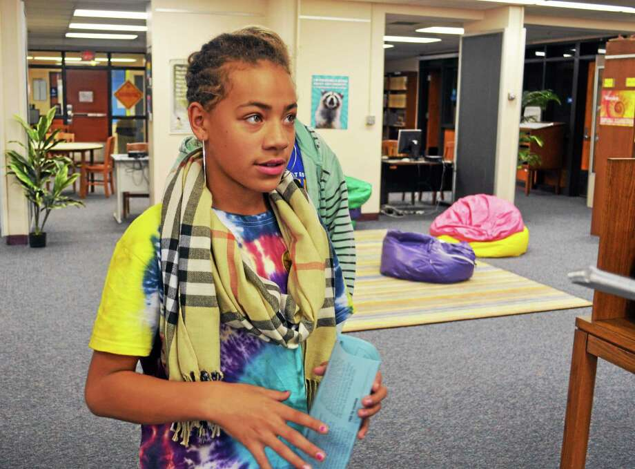Seventh-grader Diamond Gunn talks about the Woodrow Wilson Middle School water bottle project Thursday after the bottles were unveiled. Photo: Cassandra Day — The Middletown Press