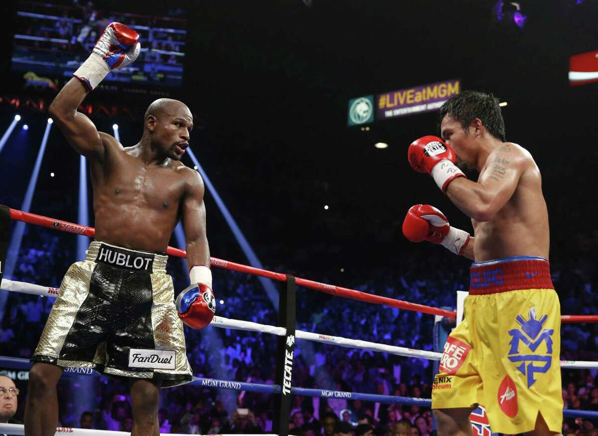 Floyd Mayweather Jr., left, celebrates during his welterweight title fight against Manny Pacquiao on Saturday in Las Vegas.