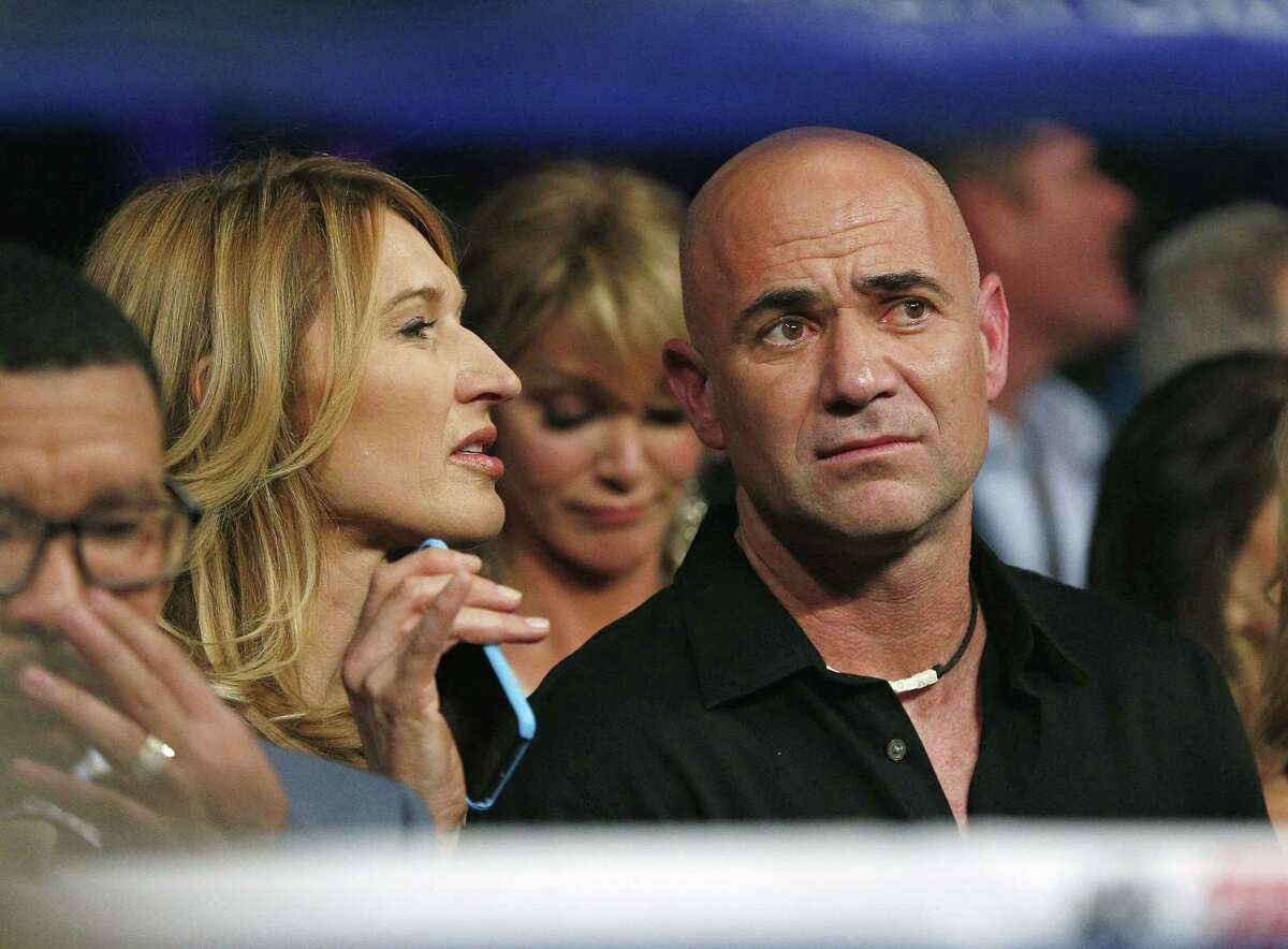 Steffi Graf, left, and Andre Agassi join the crowd before the start of the fight between Floyd Mayweather Jr. and Manny Pacquiao on Saturday in Las Vegas.
