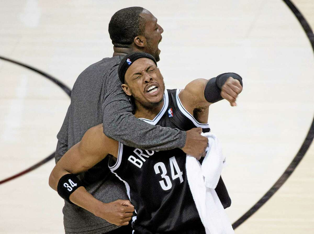 Brooklyn Nets forward Paul Pierce reacts with teammate Andray Blatche, right, after defeating the Toronto Raptors in Game 7 in Toronto on Sunday.