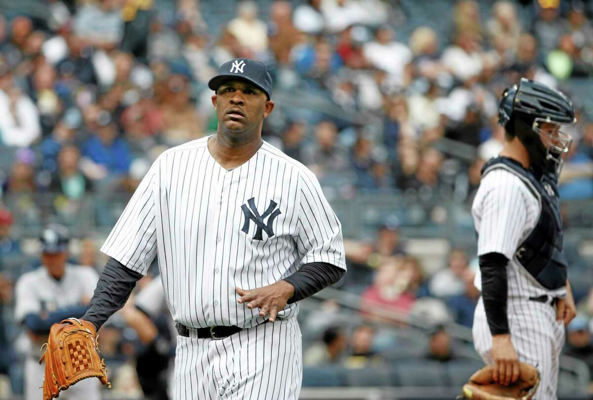 Yankees starting pitcher CC Sabathia flexes his pitching hand while leaving Sunday's game after giving up a fourth-inning double to Wil Myers on Sunday.