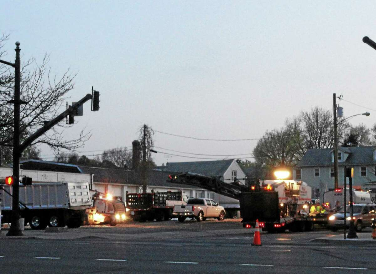 Cassandra Day - The Middletown Press Public works crews mill and pave Grand Street near Main Sunday evening in Middletown.