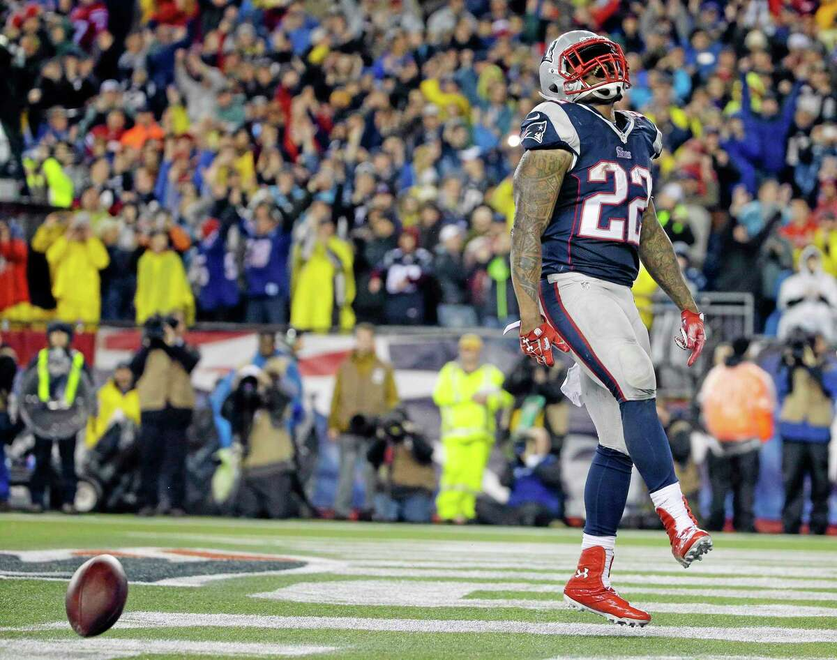 Patriots running back Stevan Ridley celebrates his touchdown during the second half of Sunday's win over the Colts.