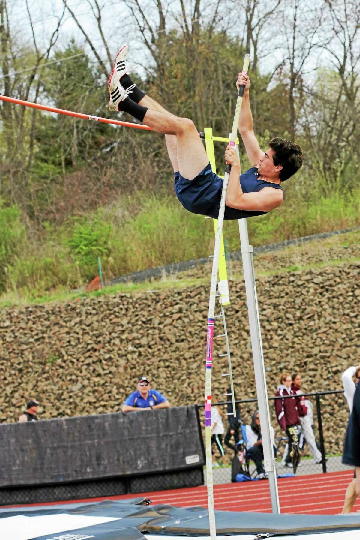 Middletown senior Jack Flynn qualifies for states in the pole vault event at Saturday's Middletown Invitational.