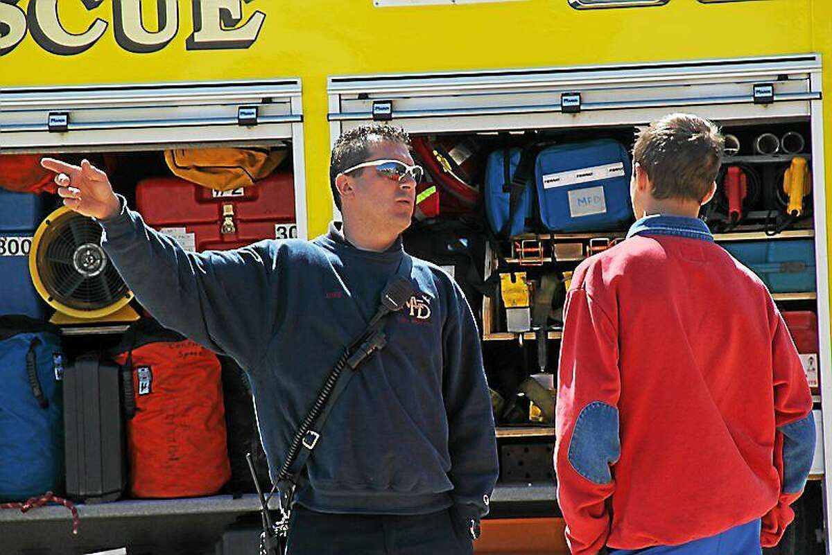 Area high school students met more then 200 professionals, including Middletown firefighters, offering career options during the career fair April 30 at the Freeman Athletic Center at Wesleyan University.