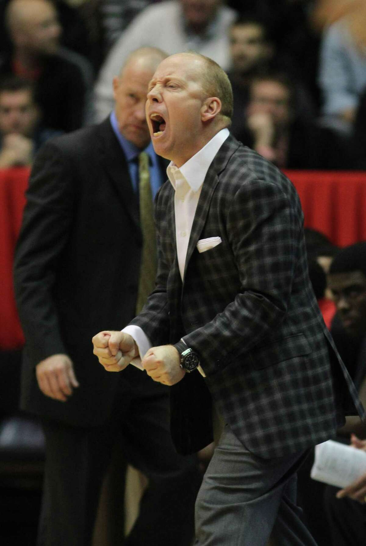 Bearcats coach Mick Cronin directs players during a game against San Diego State on Dec. 17 in Cincinnati.