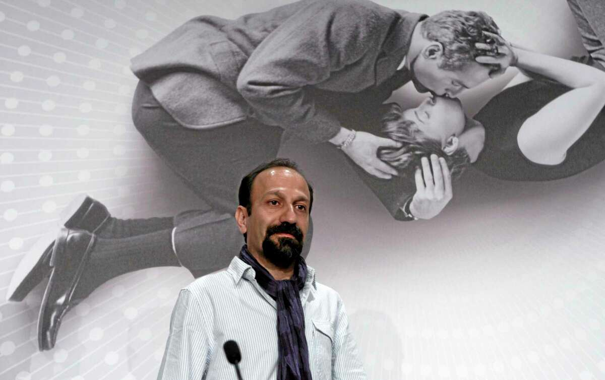 """FILE - In this May 17, 2013 file photo, Director Asghar Farhadi arrives for a press conference for """"The Past"""" at the 66th international film festival, in Cannes, southern France. Four of the five directors of Golden Globe-nominated foreign-language films, Paolo Sorrentino, """"A Great Beauty,"""" Abdellatif Kechiche, """"Blue Is the Warmest Color,"""" Thomas Vinterberg, """"The Hunt,"""" and Farhadi, """"The Past,"""" gather in Hollywood for a panel symposium on their films nominated for Best Foreign Language Film at The Egyptian Theatre on Saturday, Jan. 11, 2014. Hayao Miyazaki, whose film, """"The Wind Rises"""" is also nominated in the same category, is unable to attend. (AP Photo/Virginia Mayo, File)"""