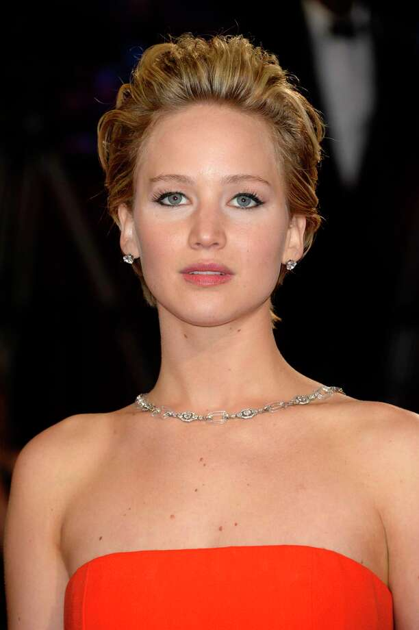 FILE - In this Sunday, March 2, 2014, file photo, Jennifer Lawrence arrives at the Oscars at the Dolby Theatre in Los Angeles. A publicist for Lawrence says the actress has contacted authorities after nude photos of her were apparently stolen and posted online. Intimate images of the Oscar-winning actress began appearing online on Sunday, Aug. 31, 2014, and nude images purported to be of other female celebrities were also being circulated online. The source of the leak was not immediately known.  (Photo by Dan Steinberg/Invision/AP, File) Photo: Dan Steinberg/Invision/AP / Invision
