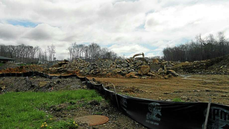 Cassandra Day - The Middletown Press Construction has begun on an ambitious mixed-use development in East Hampton - Edgewater Hill. Photo: Journal Register Co.