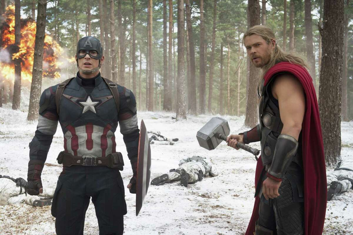 """This photo provided by Disney/Marvel shows, Chris Evans, left, as Captain America/Steve Rogers, and Chris Hemsworth as Thor, in a scene of the new film, """"Avengers: Age Of Ultron."""""""