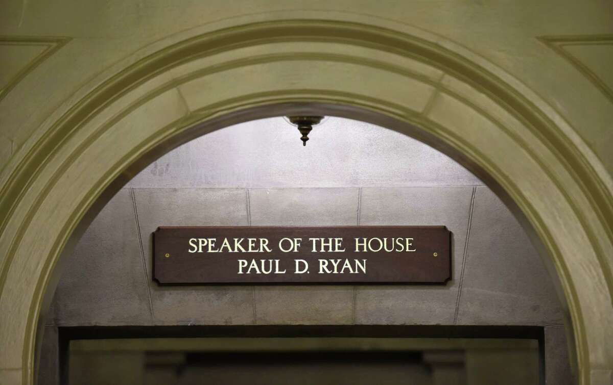 The new sign for new House Speaker Paul Ryan of Wis., is seen above the hallway leading to Ryan's office on Capitol Hill in Washington Friday. Ryan became the 54th speaker of the House on Thursday in a day of high political theater, a young new leader for a fractured Congress, charged with healing Republican divides and quieting the chaos of Capitol Hill.