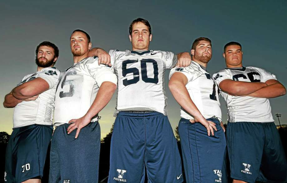 Yale is the highest-scoring offense in the FCS, thanks in large part to offensive linemen, from left, Ben Carberry (right tackle), Mason Friedline (right guard), Luke Longinotti (center), Will Chism (left guard) and Khalid Cannon (left tackle). Photo: Peter Hvizdak — Register  / ©2014 Peter Hvizdak
