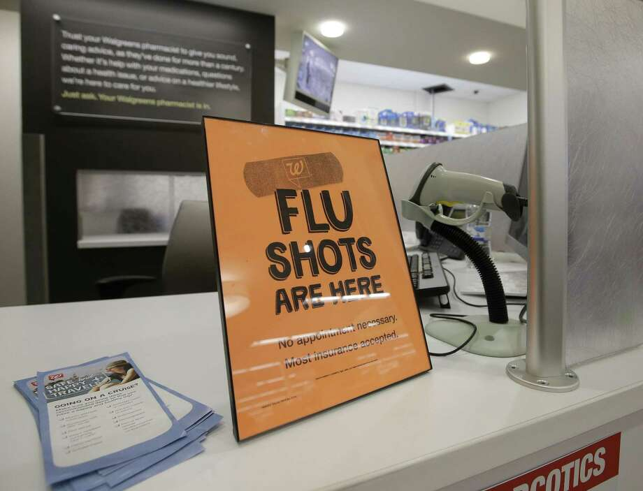 FILE - In this Sept. 16, 2014 file photo, a sign lets customers know they can get a flu shot at a Walgreen store in Indiana. Photo:  (AP Photo/Darron Cummings, File) / AP