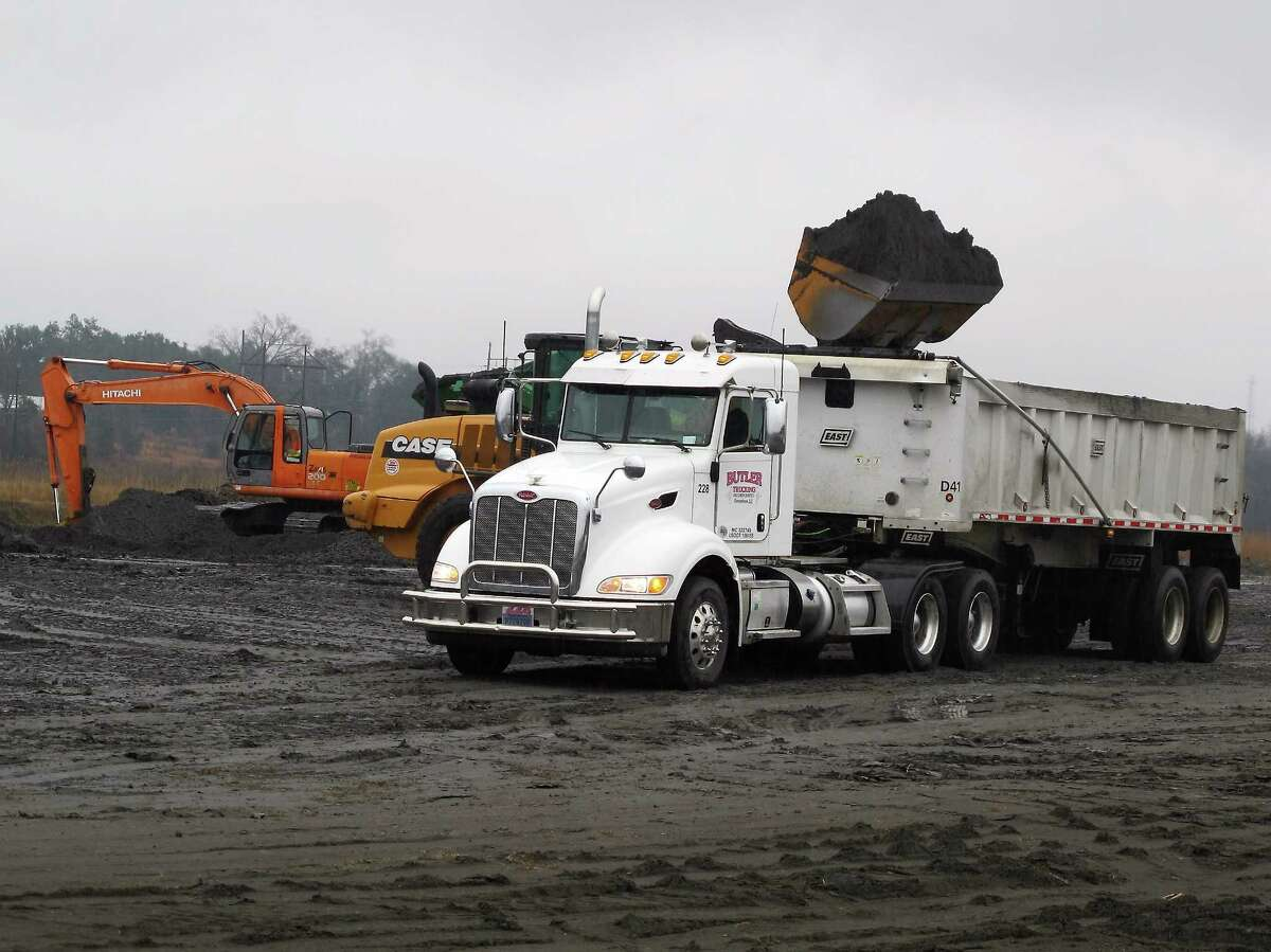 In a Feb. 26, 2014, file photo, coal ash is loaded into a truck at the Jefferies power generating station just outside Moncks Corner, S.C., operated by Santee Cooper, South Carolina's state-owned electric and water utility. Last year, the Environmental Protection Agency proposed that South Carolina reduce carbon dioxide emissions from power plants by more than half by the year 2030.
