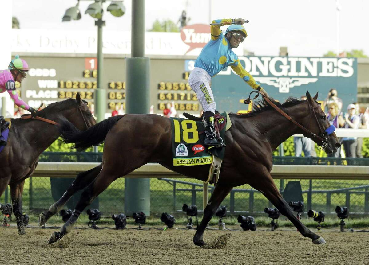 Victor Espinoza rides American Pharoah to victory in the 141st running of the Kentucky Derby on Saturday at Churchill Downs in Louisville, Ky.