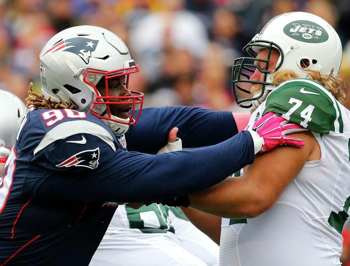 Patriots defensive tackle Malcom Brown battles Jets center Nick Mangold earlier this season.