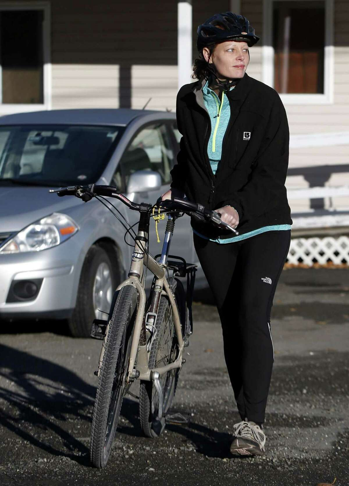Nurse Kaci Hickox leaves her home on a rural road in Fort Kent, Maine, to take a bike ride with her boyfriend Ted Wilbur, Thursday, Oct. 30, 2014. (AP Photo/Robert F. Bukaty)