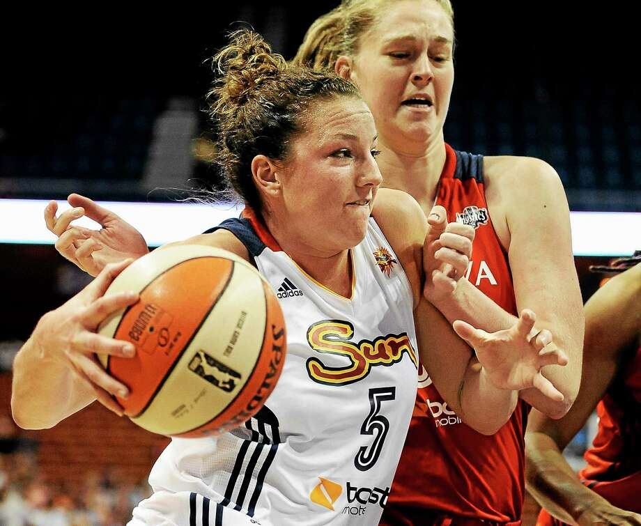 The Connecticut Sun's Kelsey Griffin drives to the basket as the Washington Mystics' Emma Meesseman defends during a 2013 game in Uncasville. Photo: Jessica Hill — The Associated Press File Photo  / FR125654 AP