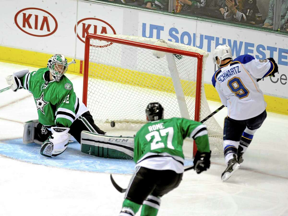 St. Louis Blues left wing Jaden Schwartz (9) puts the puck past Stars goalie Kari Lehtonen during a Dec. 29 game in Dallas. Schwartz, the younger brother of Mandi Schwartz, the Yale women's hockey player who lost her battle with leukemia in 2011, and his teammates will practice at Ingalls Rink on Jan. 24 as part of a fundraiser for the Mandi Schwartz Foundation.