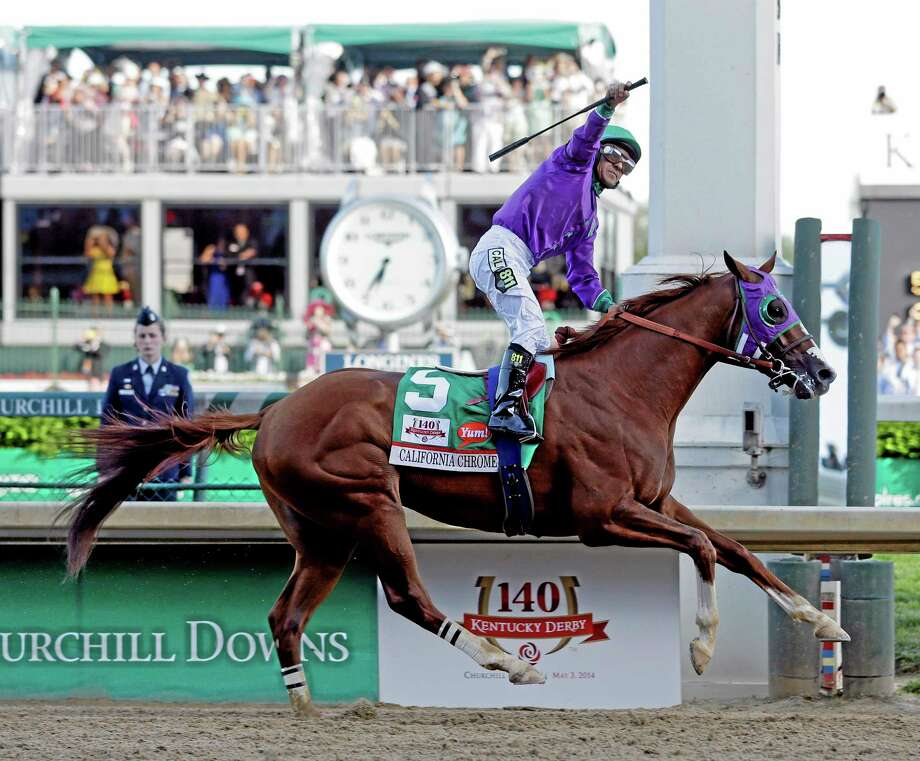 Victor Espinoza rides California Chrome to victory during the 140th running of the Kentucky Derby on Saturday at Churchill Downs in Louisville, Ky. Photo: Morry Gash — The Associated Press  / AP