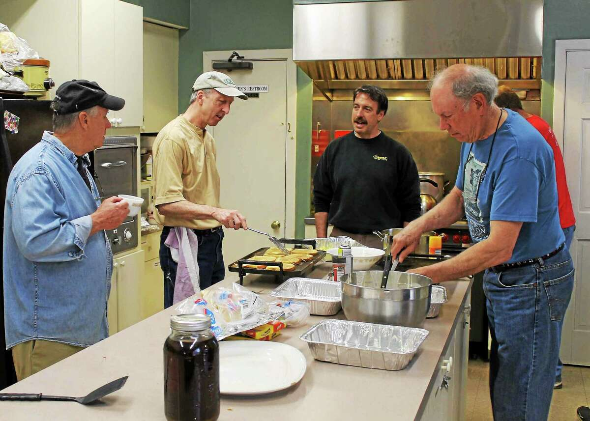 """CAUTION! MEN COOKING. The men of The First Congregational Church in Essex will do all the cooking for the church's annual May Breakfast on May 9. Chefs hard at work at last year's breakfast are (l to r) Pat Callahan of Essex, Mark Foster of Ivoryton, and John Bogaert and Alan Macgregor, both of Essex. On the day of the May Market in Essex Village, The First Congregational Church in Essex, UCC, is sponsoring a May Breakfast on Saturday, May 9 from 6:30 a.m.. to 10:00 a.m. in Fellowship Hall of the Church, 6 Methodist Hill in Essex. The breakfast is a tradition that dates back nearly one hundred years at the church. Proceeds benefit the Essex Community Fund, as well as the missions of the church A complete breakfast will be prepared and served by members and friends of the Church. The menu includes pancakes, eggs, bacon, sausage, oatmeal, coffee, tea, juice and homemade muffins. There will be a selection of """"May Baskets"""" up for bid or outright purchase, including a Mother's Day Basket, Italian Dinner Basket, Breakfast/Kitchen Basket and Gardener's Basket, among others. The cost is $7.00 for adults and $3.00 for children under 12. Tickets are available at the door. For more information, call the Church Office at 767-8097."""