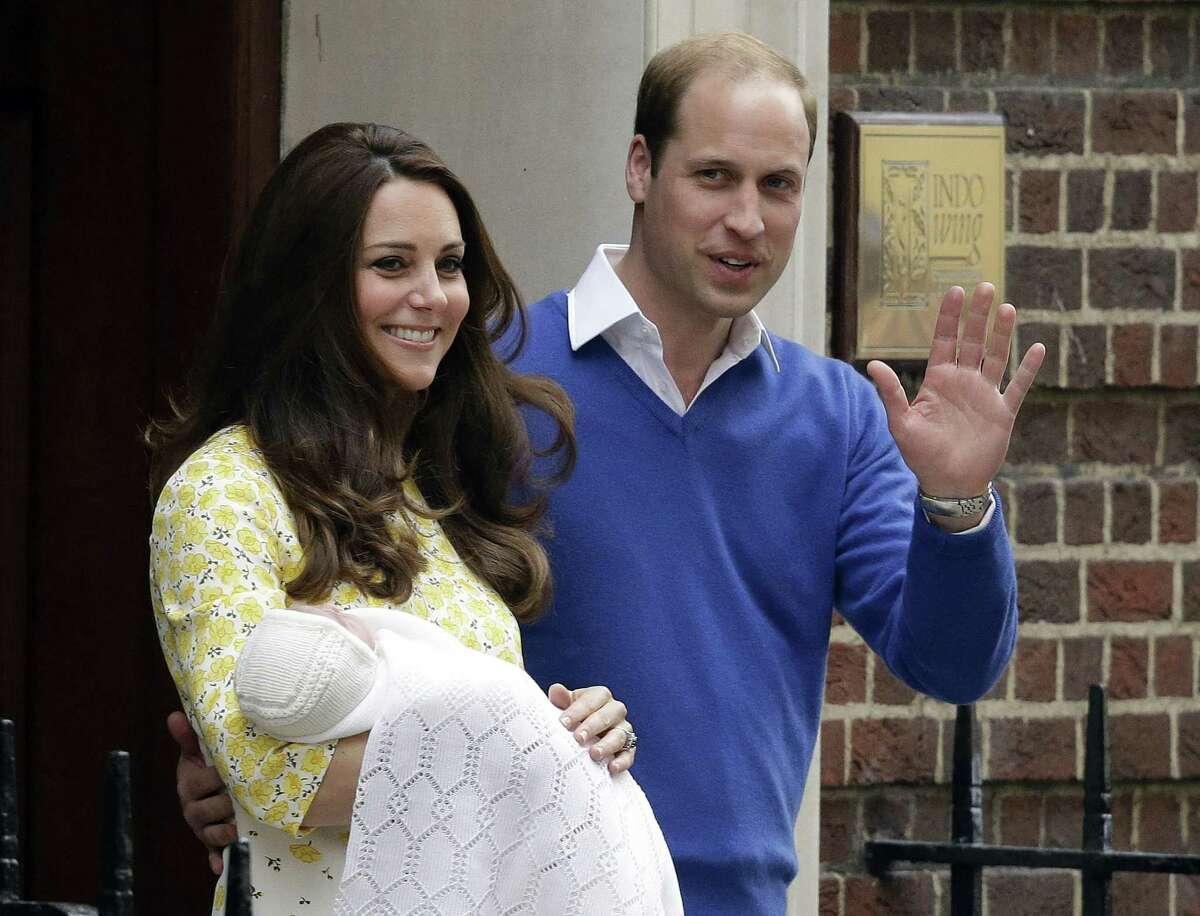 Britain's Prince William and Kate, Duchess of Cambridge and their newborn baby princess, pose for the media as they leave St. Mary's Hospital's exclusive Lindo Wing, London, Saturday, May 2, 2015. Kate, the Duchess of Cambridge, gave birth to a baby girl on Saturday morning. (AP Photo/Matt Dunham)