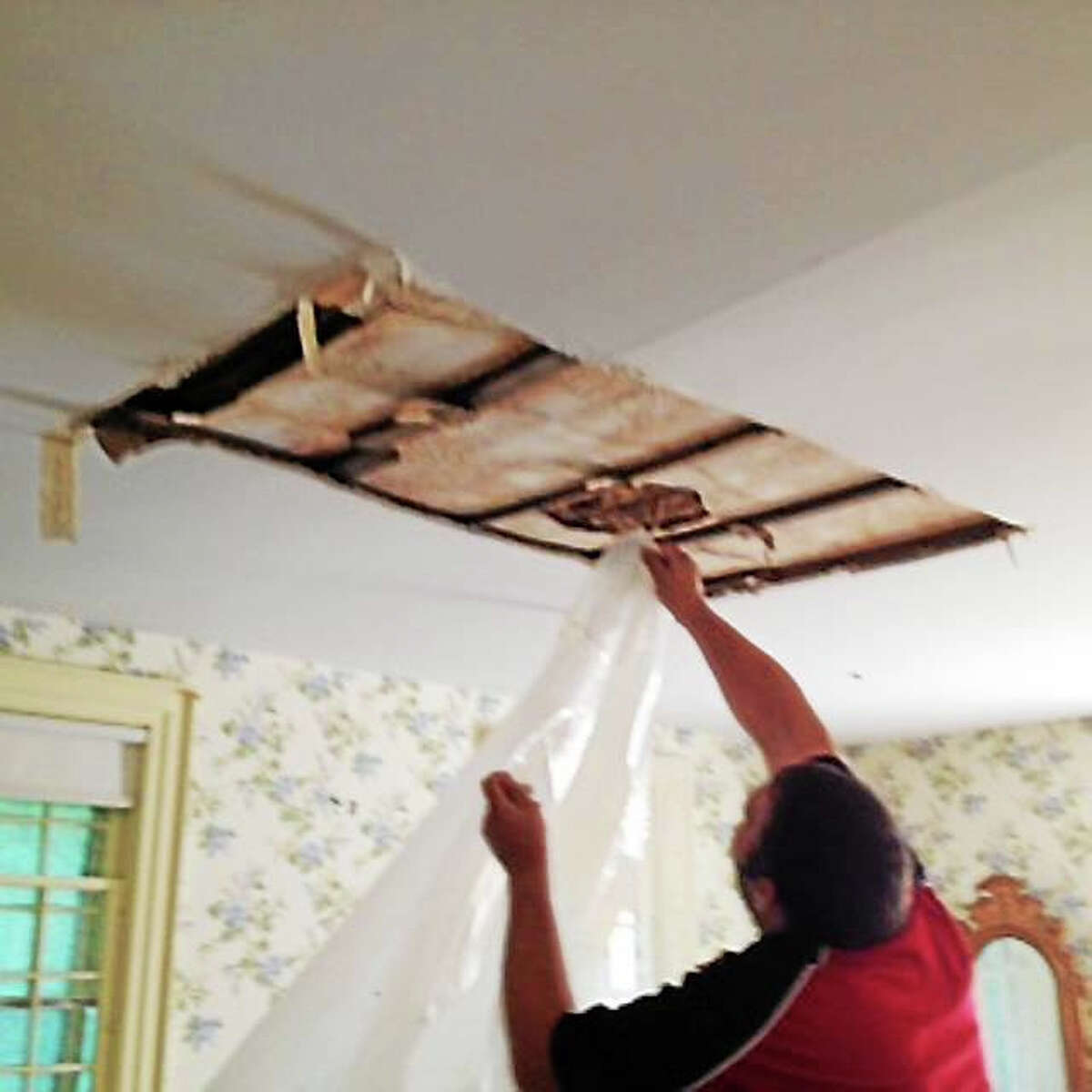 Staff and volunteers from the Shelton Historical Society worked Thursday to identify which artifacts needed repair after water from heavy storms got into the the Brownson House, which houses the Shelton History Center.