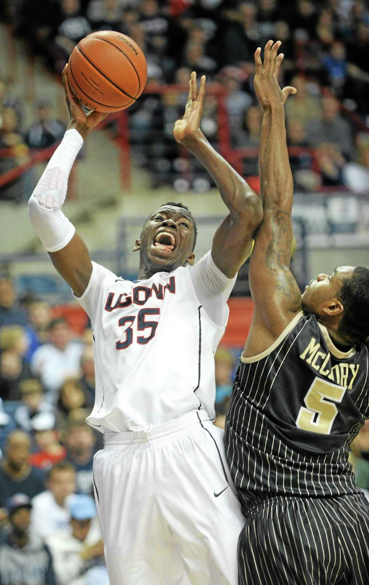 UConn's Amida Brimah looks to make a shot past the reach of Central Florida's Eugene McCrory during the second half of the Huskies' 84-61 win on Saturday in Storrs.