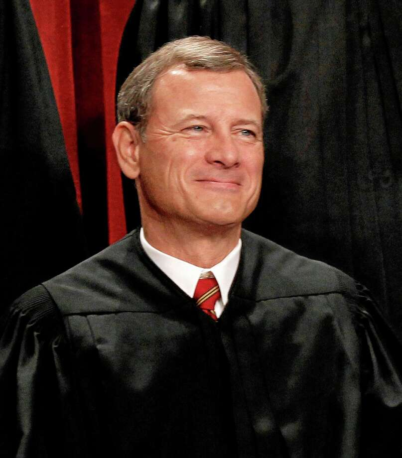 EMBARGOED UNTIL 6 PM, TUESDAY, DEC. 31, 2103 - FILE - In this Oct. 8, 2010 file photo, Chief Justice John Roberts is seen during the group portrait at the Supreme Court Building in Washington. Congress and the White House need to restore funding to the nationís federal courts to keep from undermining ìthe publicís confidence in all three branches of government,î Roberts said Tuesday in his year-end report. Roberts has made similar calls for more money in the past. ìI would like to choose a fresher topic, but duty calls. The budget remains the single most important issue facing the courts,î he said.  (AP Photo/Pablo Martinez Monsivais, File) Photo: AP / AP
