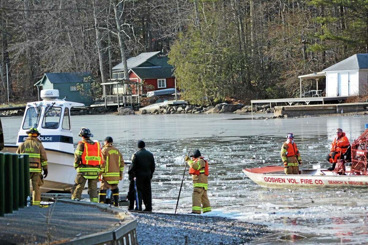 KAITLIN MCCALLUM — THE REGISTER CITIZEN An airboat from Goshen fire department breaks up ice on West Hill Pond so a state police boat could search the area for a missing kayaker.