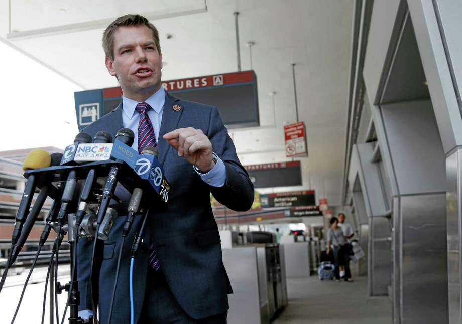 Rep. Eric Swalwell D-Calif, holds a news conference at the San Jose International Airport on Friday, May 2, 2014, in San Jose. Almost two weeks after a California teen survived a stowaway flight in a jet wheel well to Hawaii, Swalwell did his own perimeter tour of San Jose International Airport where authorities have yet to say if they know where their security was breached. (AP Photo/Marcio Jose Sanchez) Photo: AP / AP