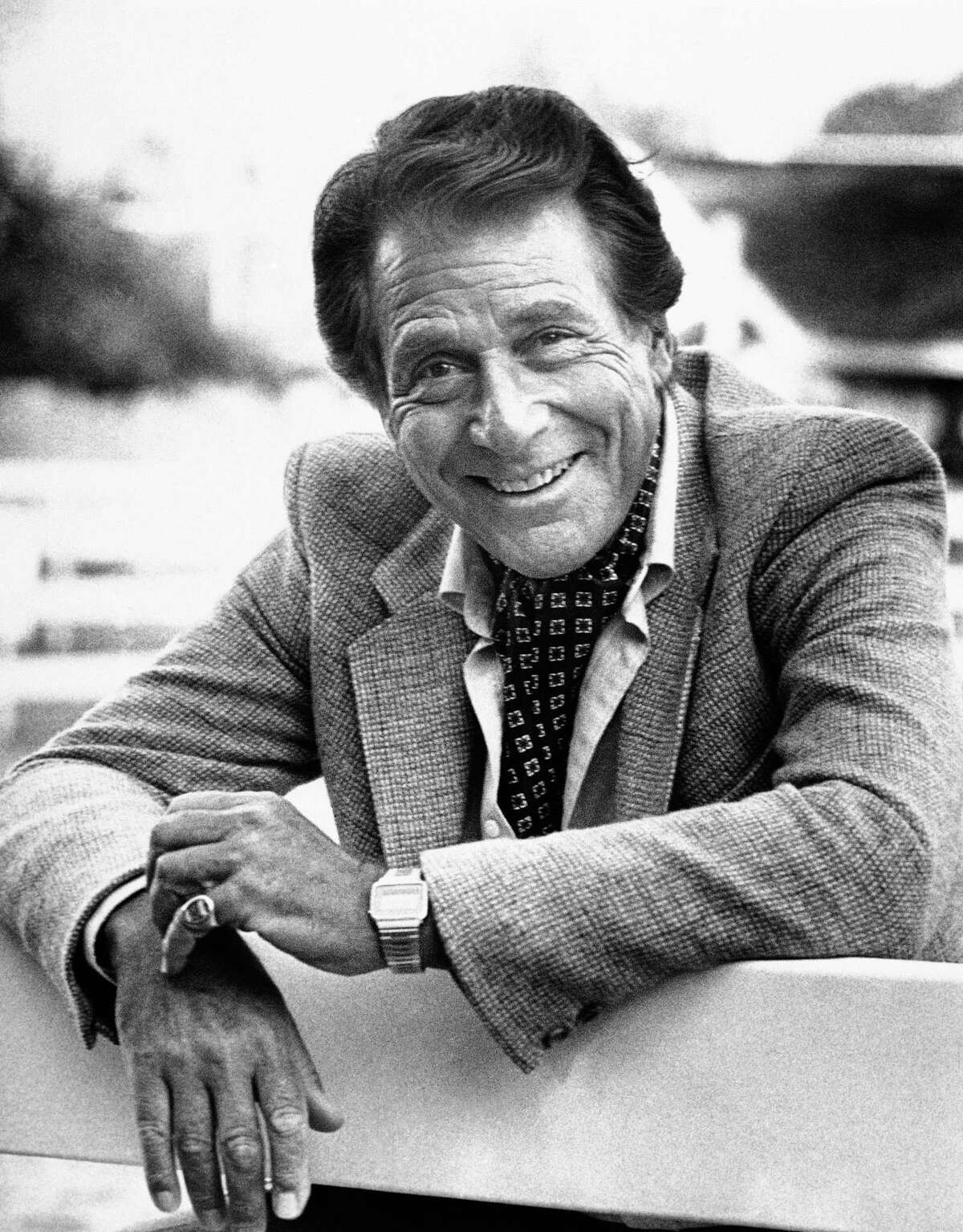 """FILE - Veteran actor Efrem Zimbalist, Jr., known for his starring roles in ì77 Sunset Stripî and ìThe FBI,î stands outside his home, in this Feb. 16, 1982 file photo taken in Los Angeles, Calif. Zimbalist, the son of famous musicians who gained television stardom in the 1950s-60s hit """"77 Sunset Strip"""" and later """"The FBI,"""" died Friday at his ranch in Solvang, Calif., at age 95. (AP Photo/Wally Fong, File)"""