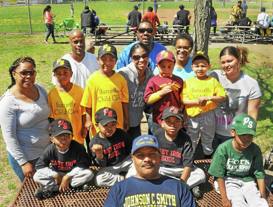 Walter Pop Smith League President, Lynair Walkwe, front, with some of the children ( and their parents) who will be participating in the Freddie Fixer Parade Sunday. Photo: Melanie Stengel - Register