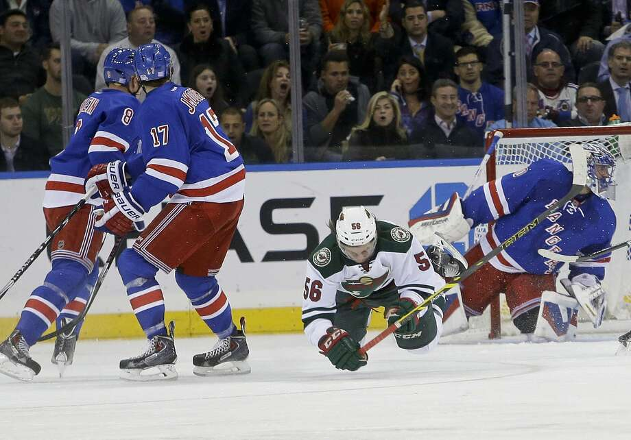 The Minnesota Wild's Erik Haula (56) falls down after being hit by the New York Rangers' John Moore (17) during the second period of Monday's game in New York. Moore was given a match penalty, and then a five-game suspension. Photo: Frank Franklin II — The Associated Press  / AP