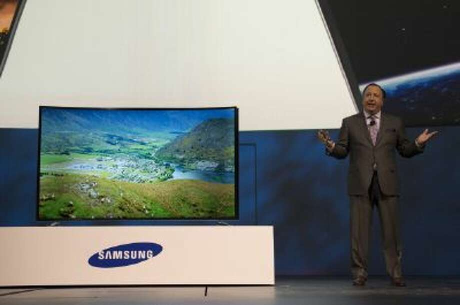 "Joseph ""Joe"" Stinziano, of Samsung Electronics America Inc., stands next to the new Samsung 105-inch curved ultra high definition (UHD) television during a news conference at the 2014 Consumer Electronics Show (CES) in Las Vegas, Nevada, U.S., on Monday, Jan. 6, 2014. Photo: Bloomberg Via Getty Images / 2013 Bloomberg"