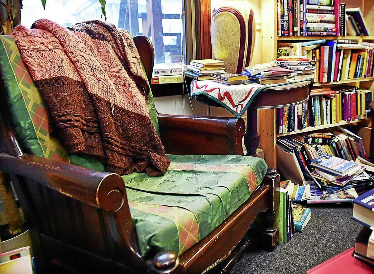 Catherine Avalone — The New Haven Register A reading nook to curl up in a comfy chair by a window at Bennett's Books in Deep River.