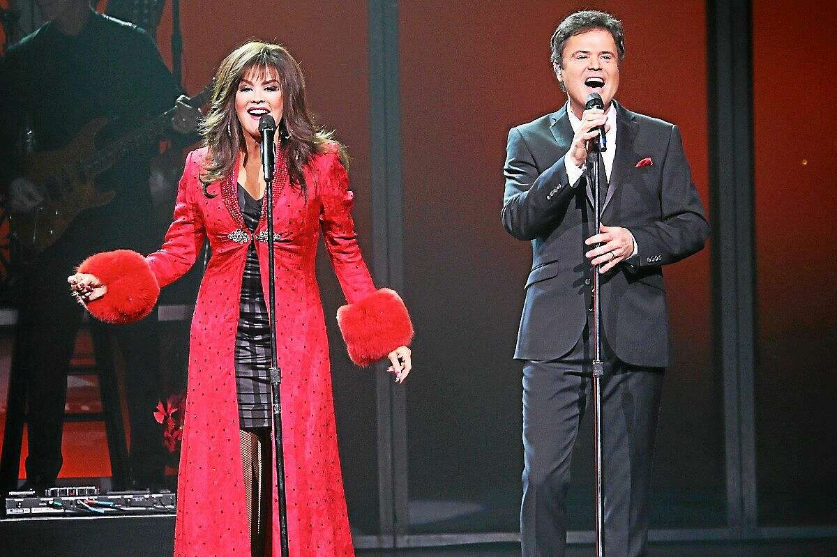 Photo by John Atashian Entertainers Marie and Donny Osmond are shown on stage during their holiday concert performance at the Grand Theater inside of the Foxwoods Casino on Saturday Dec. 27. The brother and sister act performed four shows over the holiday weekend complete with a top notch vegas style show that thoroughly entertained the capacity crowds in attendance.