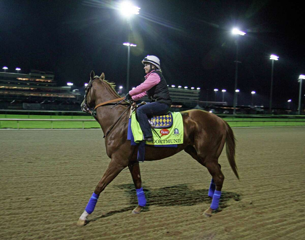 Kentucky Derby entrant Dortmund, with exercise rider Dana Barnes aboard, goes to the track for his morning gallop Friday at Churchill Downs in Louisville, Ky.