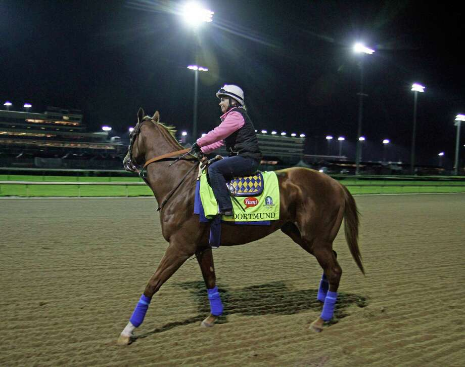 Kentucky Derby entrant Dortmund, with exercise rider Dana Barnes aboard, goes to the track for his morning gallop Friday at Churchill Downs in Louisville, Ky. Photo: Garry Jones — The Associated Press  / FR50389 AP