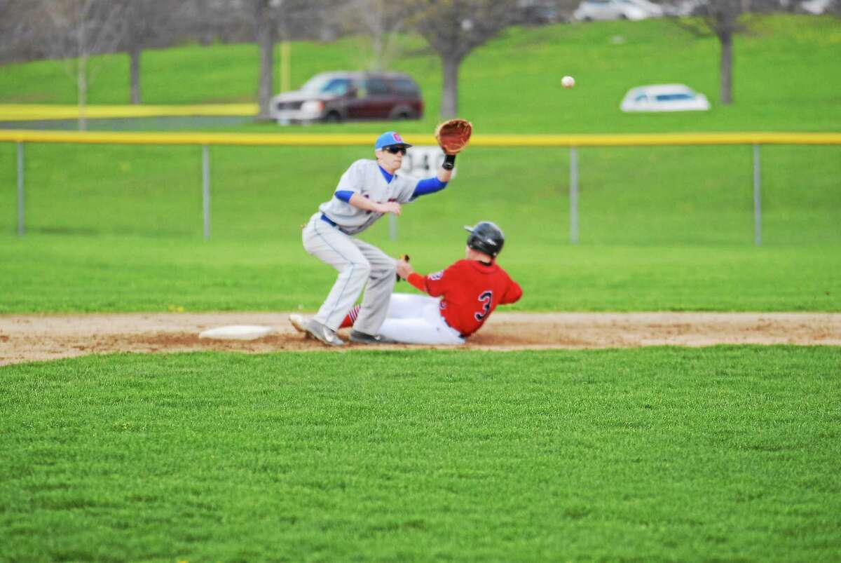 Portland's Cole Ogorzalek steals second base as Coginchaug's Eric Sbona waits for the throw in the Blue Devils 4-3 win Friday at Durham.