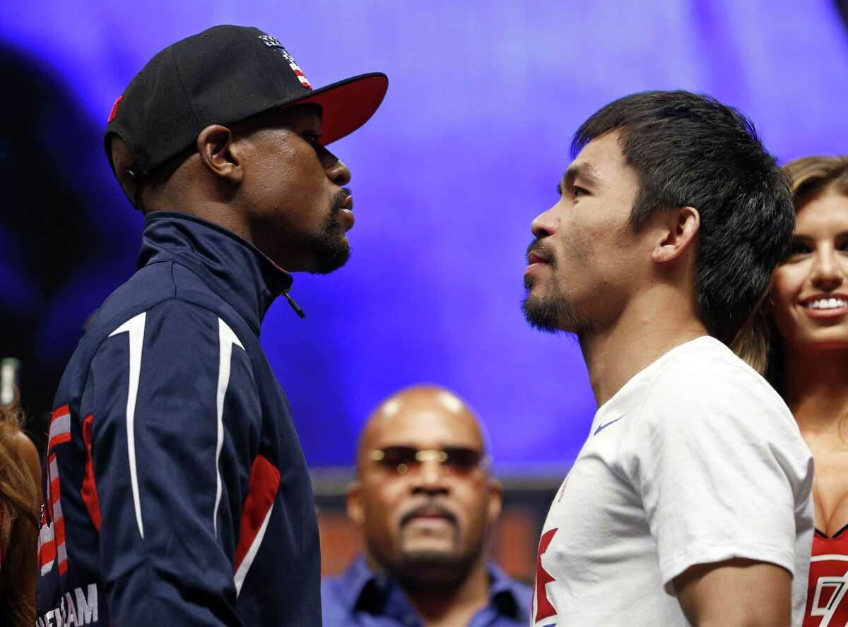 Floyd Mayweather Jr., left, and Manny Pacquiao pose during their weigh-in on Friday in Las Vegas.