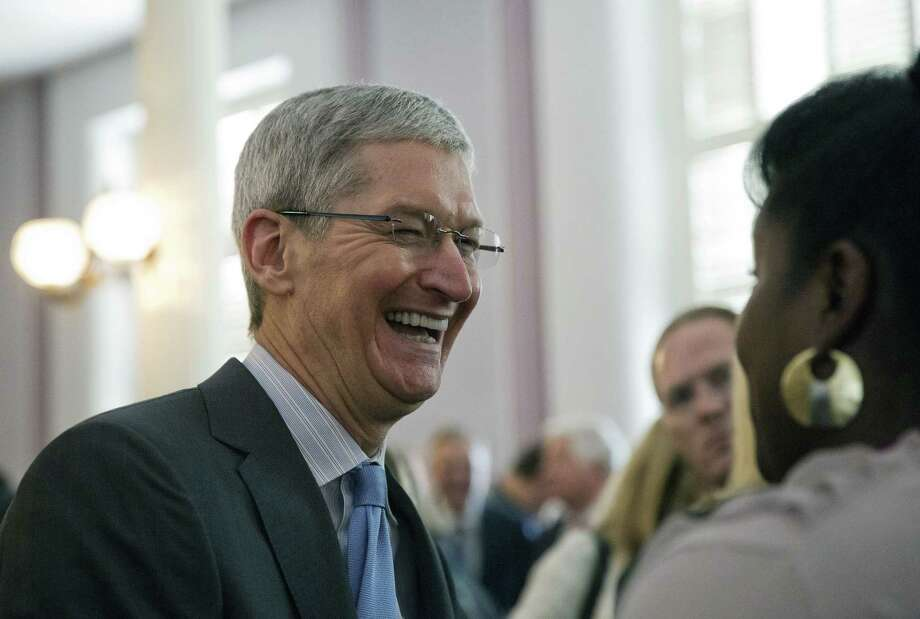 Apple chief executive and Alabama native Tim Cook laughs with a group before an Alabama Academy of Honor ceremony at the state Capitol on Oct. 27, 2014, in Montgomery, Ala. Cook and seven others including University of Alabama football coach Nick Saban were inducted into the Alabama Academy of Honor. Photo: AP Photo/Brynn Anderson  / AP