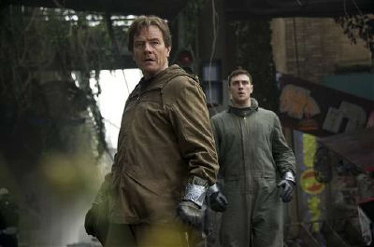 """This image released by Warner Bros. Pictures shows Bryan Cranston, left, and Aaron Taylor-Johnson in a scene from """"Godzilla."""""""