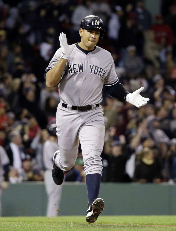 New York Yankees pinch hitter Alex Rodriguez runs to first after hitting a solo homer in the eighth inning of a baseball game against the Boston Red Sox at Fenway Park in Boston, Friday, May 1, 2015. Rodriguez has now tied slugger Willie Mays with 660 career home runs. (AP Photo/Elise Amendola) Photo: The Associated Press  / AP