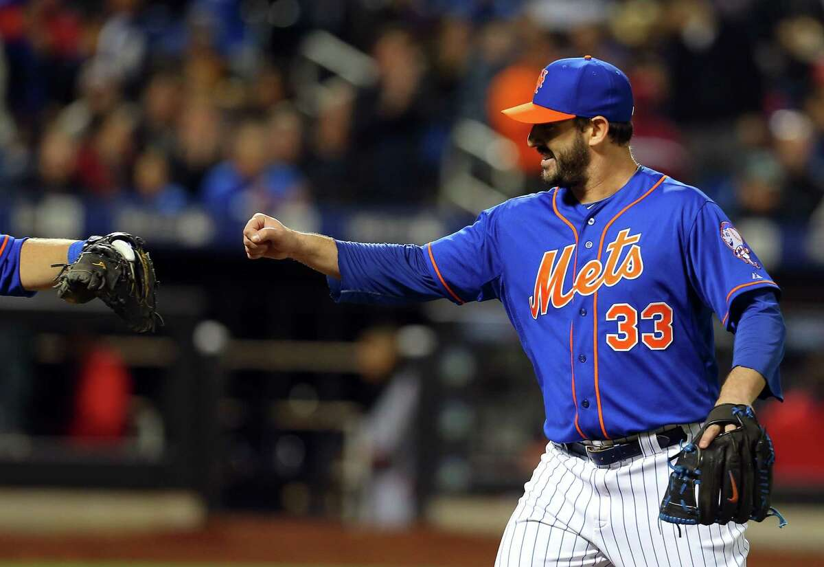New York Mets starting pitcher Matt Harvey (33) celebrates with catcher Kevin Plawecki after a call was overturned against the Washington Nationals during the sixth inning of a baseball game in New York, Friday, May 1, 2015. (AP Photo/Adam Hunger)
