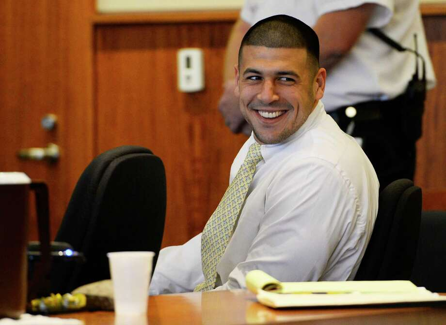 Former New England Patriots NFL football player Aaron Hernandez attends an evidentiary hearing at Bristol County Superior Court, Thursday, Oct. 2, 2014, in Fall River, Mass. Hernandez, 24, has pleaded not guilty to first-degree murder in the 2013 shooting death of Odin Lloyd, a Boston semi-professional football player who was dating the sister of Hernandez's fiancee. (AP Photo/CJ Gunther, Pool) Photo: AP / Pool EPA