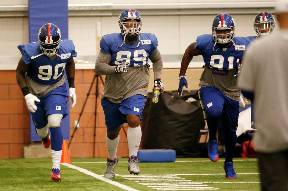 New York Giants defensive end Jason Pierre-Paul (90) works out during practice Wednesday in East Rutherford, N.J. Photo: Julio Cortez — The Associated Press  / AP