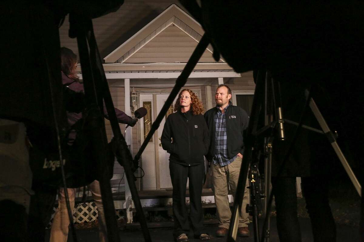 Kaci Hickox, a nurse who treated Ebola patients in West Africa, left, and boyfriend Ted Wilbur take questions from the media outside their home in Fort Kent, Maine on Wednesday, Oct. 29, 2014. Hickox, the first person forced into New Jersey's mandatory quarantine for people arriving at the Newark airport from three West African countries, vowed to defy Maine's voluntary quarantine. (AP Photo/Portland Press Herald, Whitney Hayward)