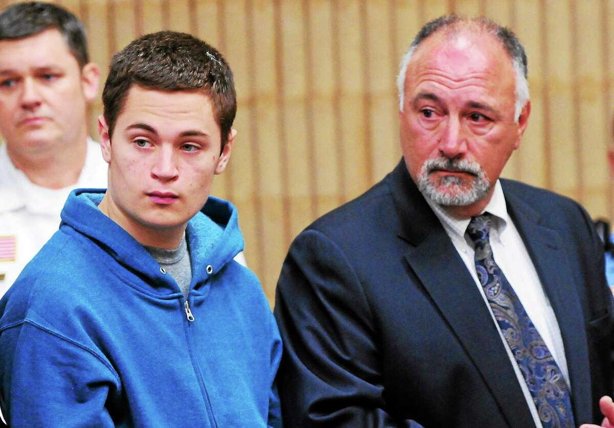 Christopher Michael Plaskon, 16, of Milford, in his first public court appearance Friday, May 2, 2014, at state Superior Court in Milford, stands with his defense attorney Richard T. Meehan Jr., far right. Plaskon is charged in the stabbing death of Jonathan Law High School classmate Maren Sanchez,